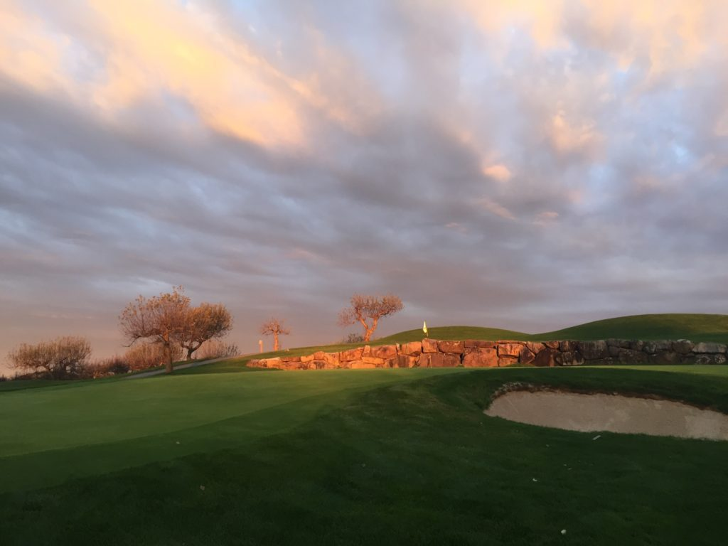 A sunset over Apple Greens Golf Course