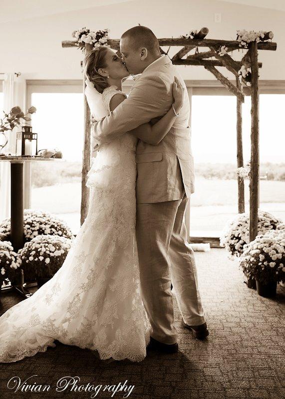 bride & groom kissing