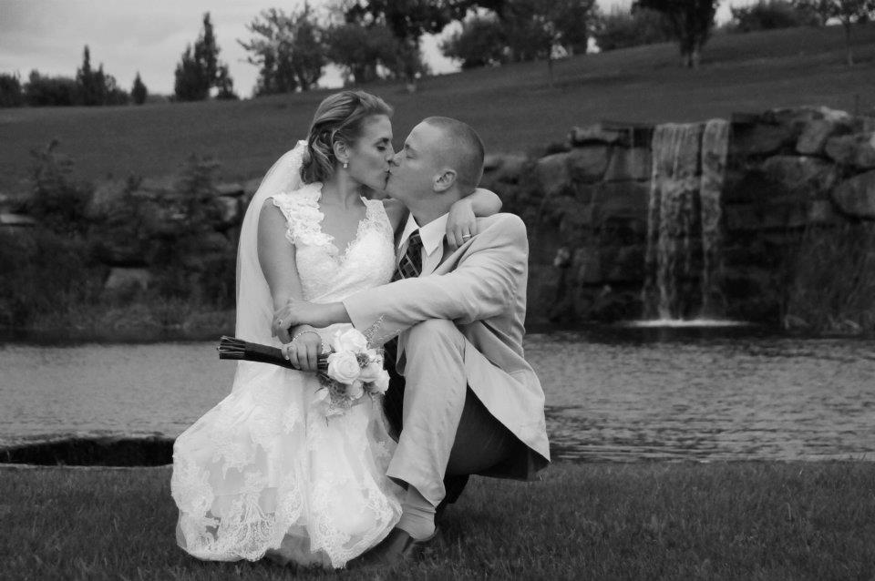 bride & groom kissing in black & white