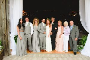 The bride and groom with their family from an Apple Greens Golf Course wedding ceremony